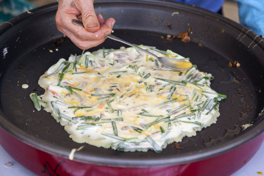 Market of Korea street food Adult Close-up Day Food And Drink Freshness Frying Frying Pan Healthy Eating High Angle View Horizontal One Man Only Outdoors Pajeon People Person Preparation
