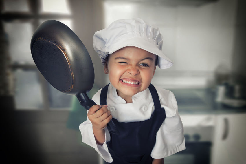 Cook girl Chef's Hat Child Childhood Cooking Elementary Age Focus On Foreground Front View Happiness Hat Indoors  Looking At Camera One Person Portrait Real People Smiling Standing Uniform