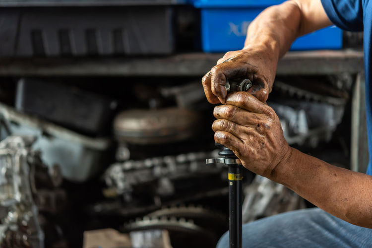 Mechanic repairing car
