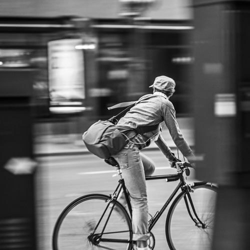 """""""Looking Back"""" Mobility In Mega Cities Mobility Bicycle Casual Clothing City City Life Land Vehicle Mode Of Transport Motion On The Move Riding Selective Focus Side View Speed Transportation Travel Women Around The World BYOPaper! The Street Photographer - 2017 EyeEm Awards Stories From The City The Street Photographer - 2018 EyeEm Awards The Modern Professional My Best Photo"""
