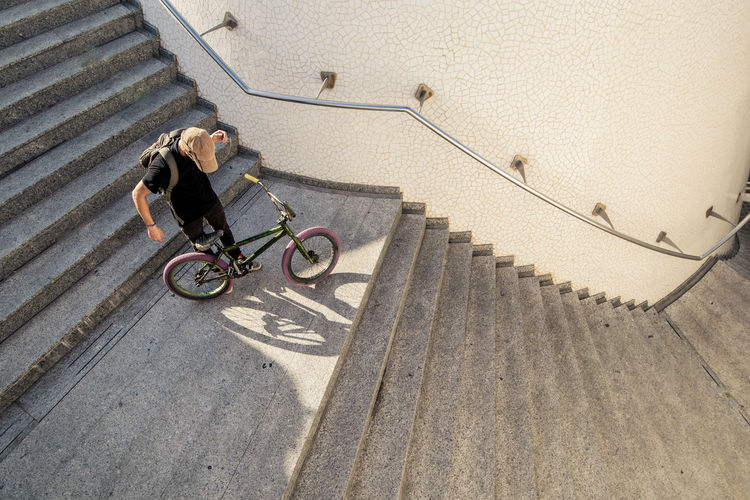 High angle view of woman on bicycle