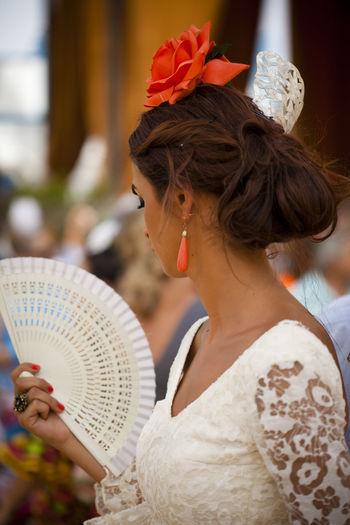 A woman in traditional flamenco dress at the Feria de Jerez, Spain Beauty Fan Femininity Feria Flamenco Flamenco Dress Person Rose🌹 Spanish Woman Traditional