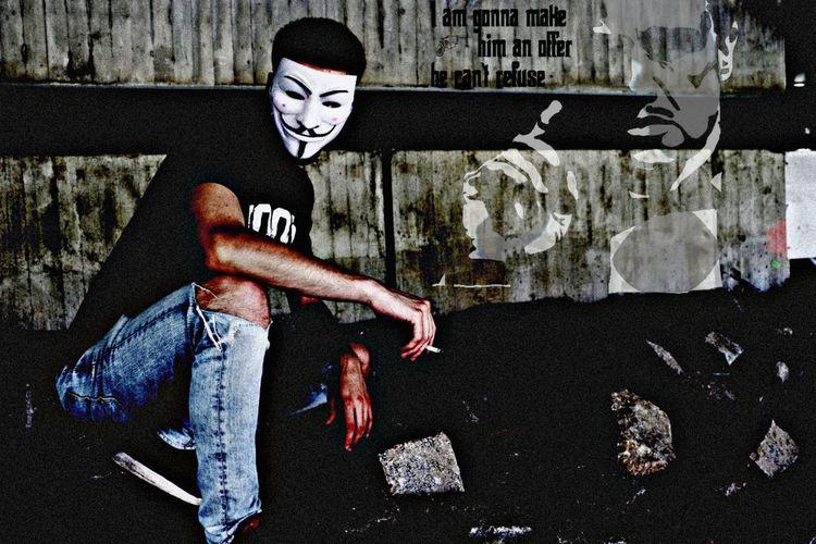 Full length of young man against graffiti wall