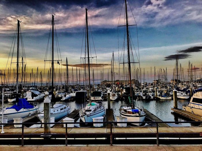 Cloud - Sky Sailboat Boat Outdoors Yacht Marina Nautical Vessel Moored Transportation Mast Mode Of Transport Harbor Sky Water In A Row Sea No People Travel Destinations Large Group Of Objects Day