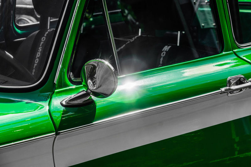 Wolfsburg, Lower Saxony, Germany, May 27, 2018: Deitail from the side of one NSU Prince, 1968, green lacquered with a white stripe, at a vintage car meeting, Fallersleben NSU Prinz Nsu Car Close-up Day Green Color Industry Land Vehicle Lighting Equipment Metal Mode Of Transportation Motor Vehicle No People Outdoors Public Transportation Reflection Retro Styled Silver Colored Train - Vehicle Transportation Travel Vintage Car