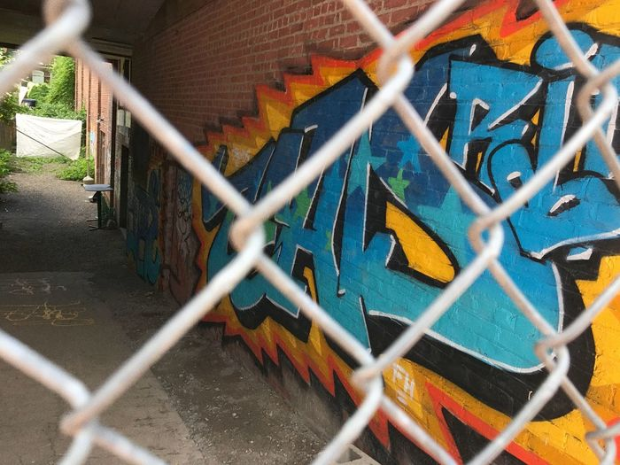 Graffiti Chainlink Fence Blur Building Exterior Architecture Clear Sky EyeEmNewHere