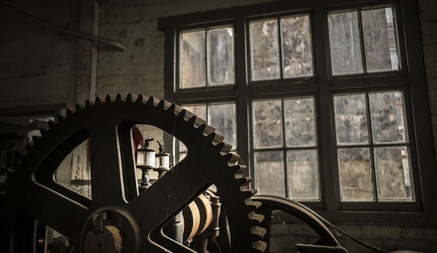 Abandoned Architecture Built Structure Close-up Day Focus On Foreground Gear Glass - Material Indoors  Industry Machine Part Machinery Metal No People Old Shape Transparent Wheel Window