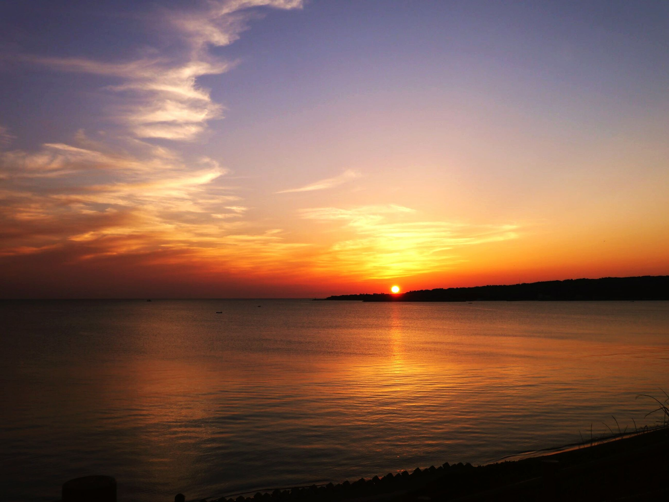 sunset, water, scenics, tranquil scene, sea, tranquility, beauty in nature, orange color, horizon over water, sky, reflection, idyllic, nature, sun, silhouette, beach, cloud - sky, outdoors, calm, cloud