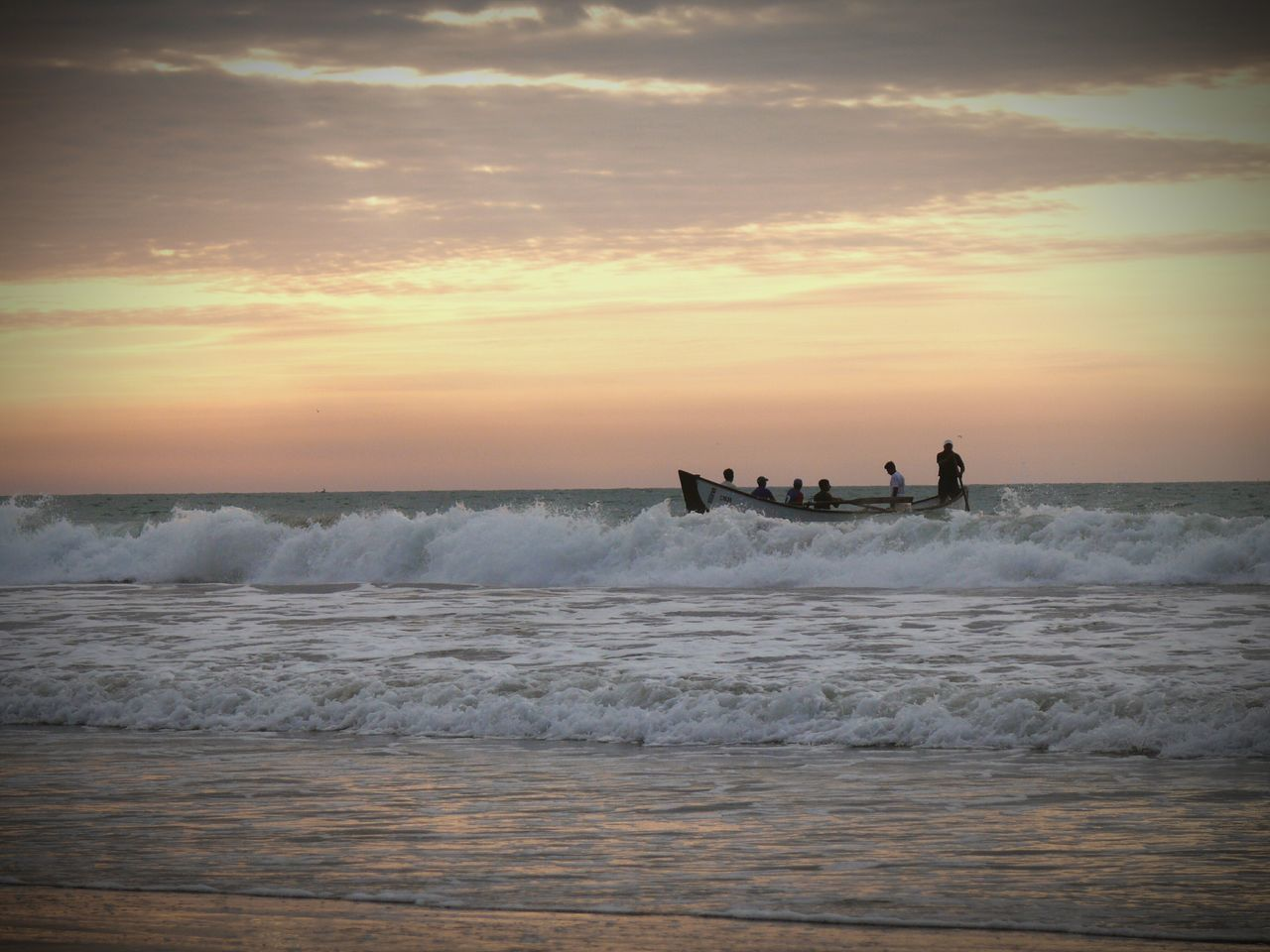 People In Boat On Sea Against Sunset Sky