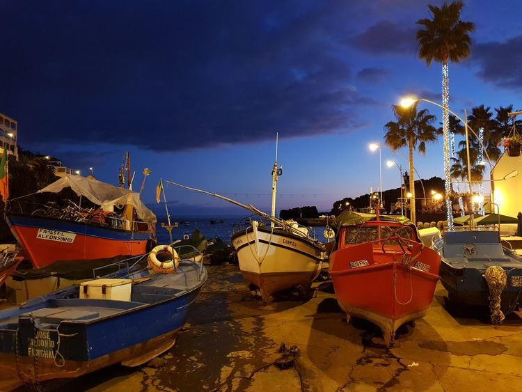 Fishermen Boats Night Landscape_Collection Landscape_photography Village Red Color Blue Color Yellow Color Atmospheric Bildfolge Photography Vacation Time Madeira Island Atlantic Ocean Nautical Vessel Reflection Moored Sea Night Harbor Sky Cloud - Sky No People Outdoors Beach Landscape Star - Space Nature City
