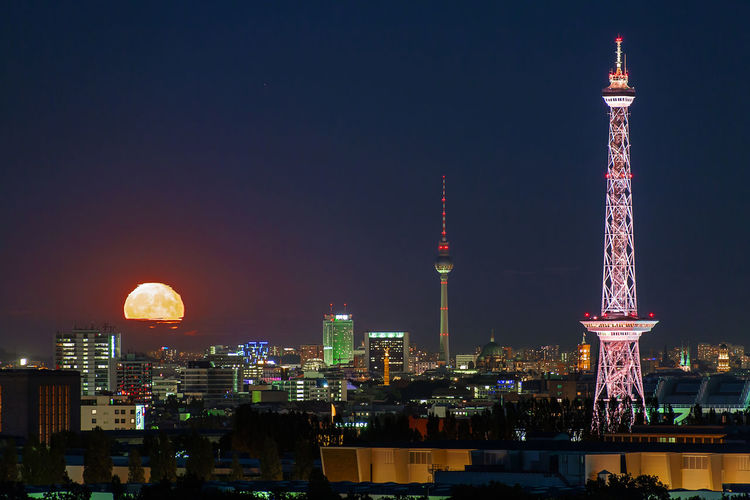 Architecture Berlin Building Exterior Business Finance And Industry City City Life Cityscape Downtown District Fullmoon Illuminated Moonrise Night No People Outdoors Radiotower Sky Skyline Skyline Berlin Skyscraper Tower Travel Travel Destinations Tvtower Urban Skyline