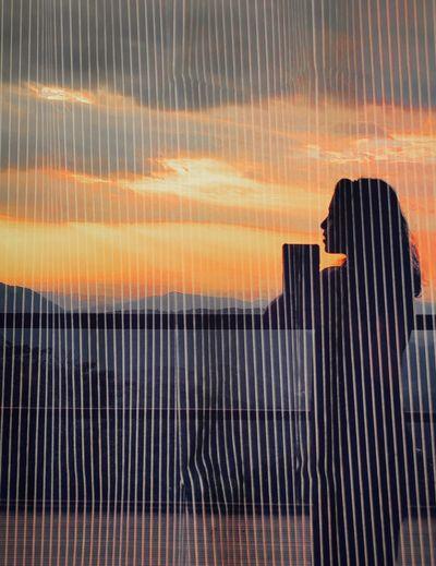 Full frame shot of metal fence during sunset