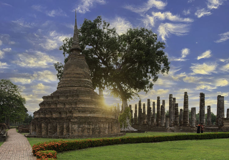 Trees in a temple against sky