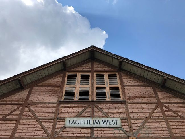 …and catching a train towards Oberkochen (via Ulm). Train Station Bahnhof Architecture Built Structure Sky Cloud - Sky Building Exterior Low Angle View Text Sign