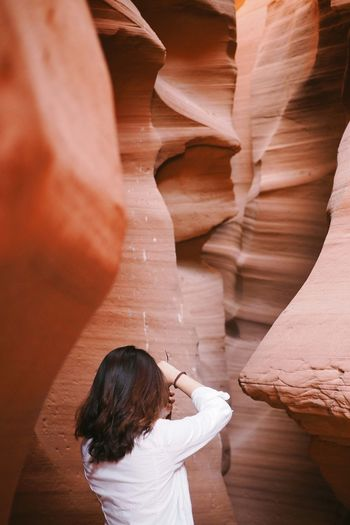 In the middle of Antelope Canyon. Adult Adults Only Antelope Canyon Beauty In Nature Canyon Day Nature One Person One Woman Only Only Women Outdoors People Roadtrip Travel Travel Destinations USA USA Photos USAtrip theweekoneyeem Enjoy The New Normal