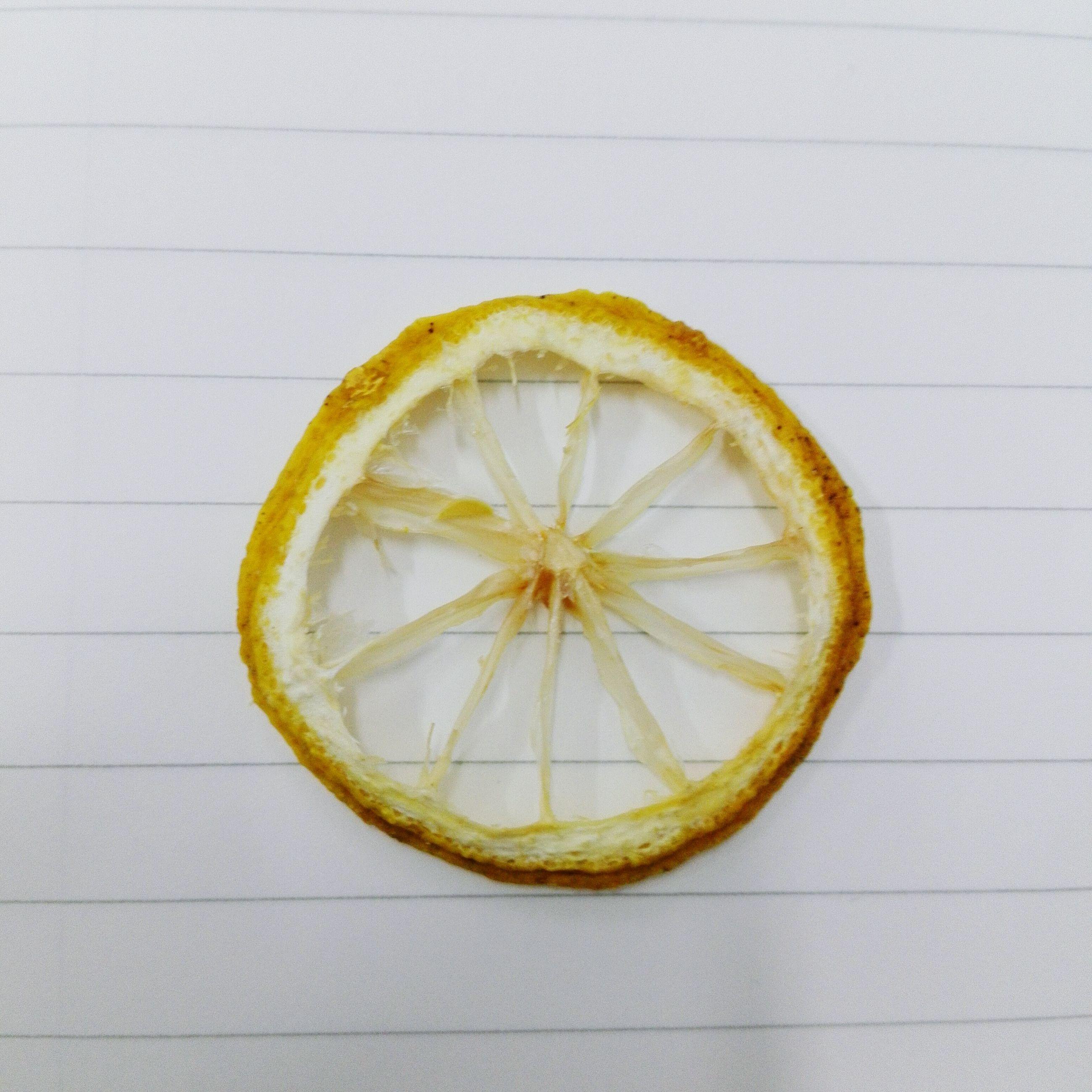 food and drink, lemon, clock, yellow, fruit, geometric shape, circle, round, messy, circular, no people