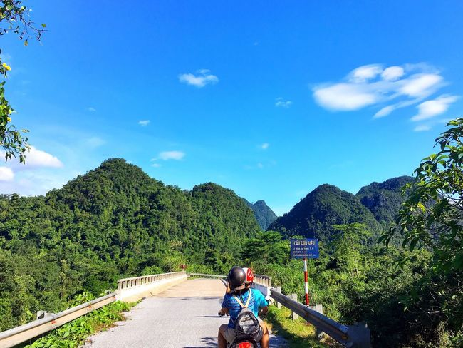 Where do you want to go? EyeEmNewHere Tree Real People Sky Day Beauty In Nature Railing Outdoors Nature Rear View Cloud - Sky Transportation Lifestyles Mountain Growth Scenics Men Forest Sitting Full Length People Travel Destinations Vietnam Traveling