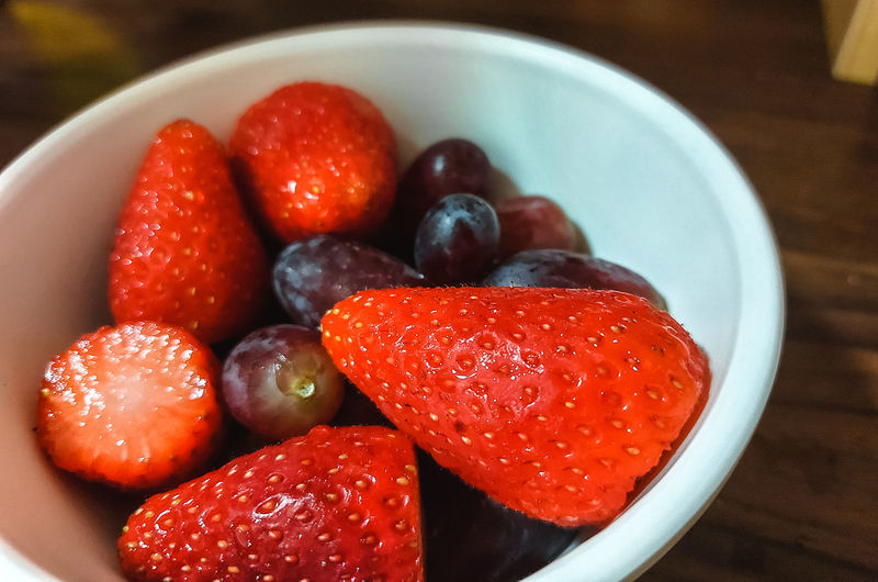 High angle view of strawberries in bowl on table
