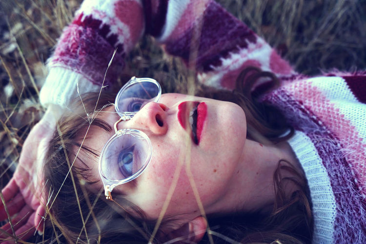 Close-up Day Headshot Human Face Lying Down One Person Outdoors People Real People Warm Clothing Young Adult Young Women