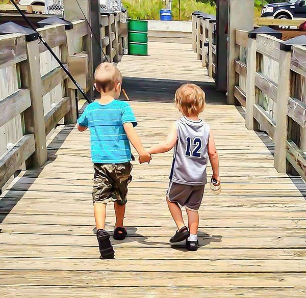 Childhood Rear View Casual Clothing Togetherness Children Only Full Length Two People Child Outdoors People Day Water Adult Friends Friendship Holding Hands Walking Together Fishing Fishing Buddies Buddies Pier Dock Wooden Dock Weathered Wood Sun Bleached