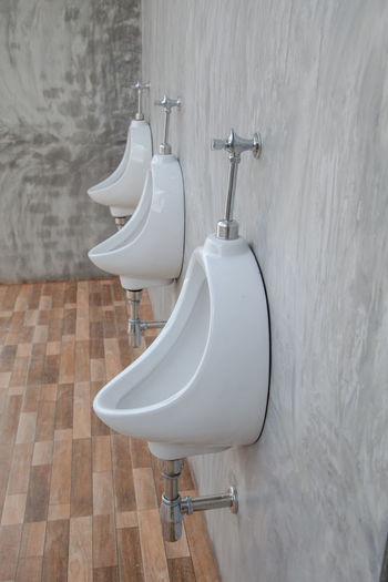 Toilet bowls in bathroom