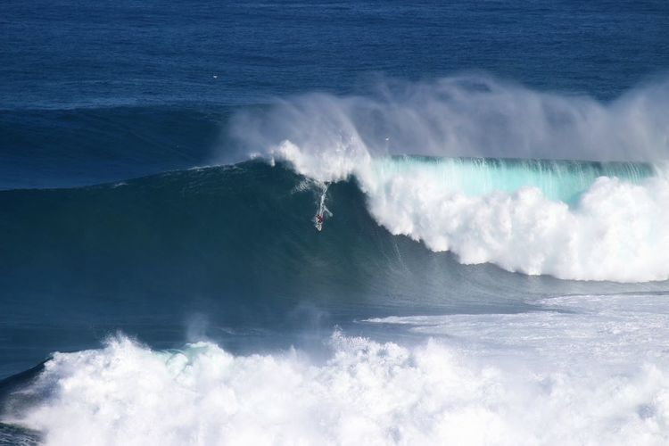 Big wave surfing at jaws maui