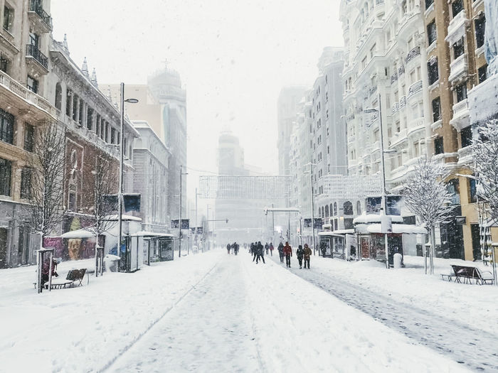 Panoramic view of city street during winter