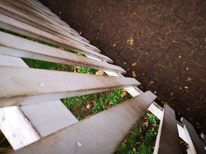 High angle view of wooden bench