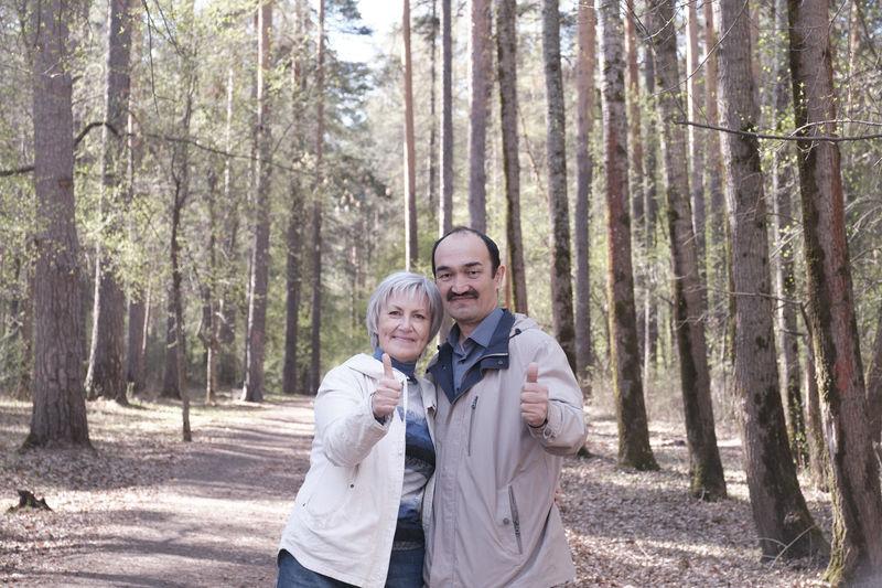 Happy friends enjoying in forest