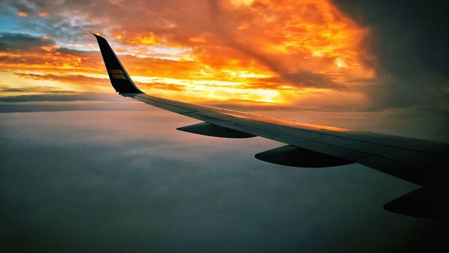 Landing in Reykjavík Icelandair Sunrise Boeing Boeing 757 Winglet Airplane Sunset Flying Silhouette Sea Dramatic Sky Air Vehicle Sky Cloud - Sky Aircraft Wing Airplane Wing Plane Aerial View Atmospheric Mood