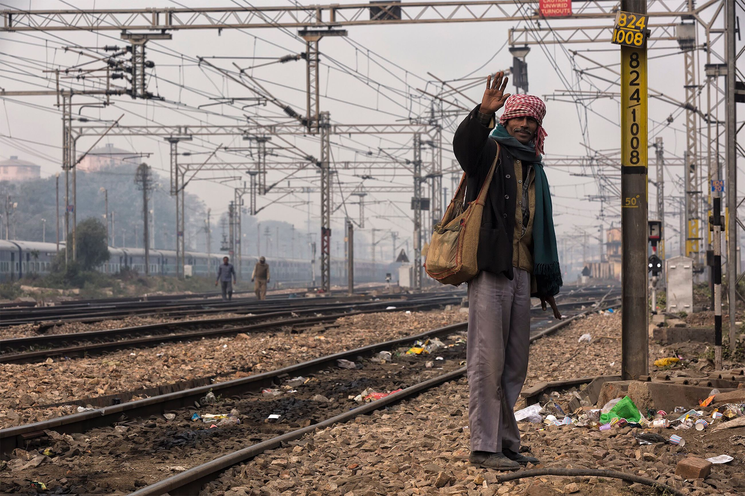 real people, railroad track, one person, full length, standing, lifestyles, outdoors, day, winter, young adult, sky, people