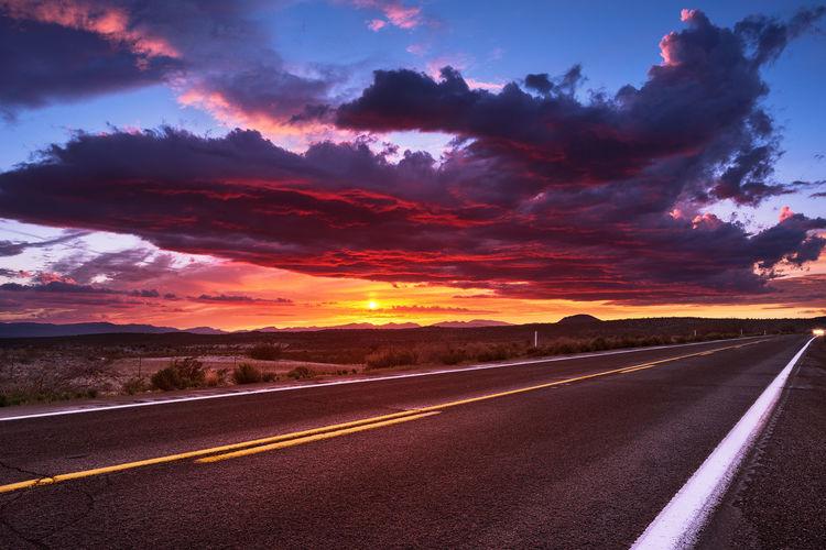 Arizona sunset Arizona Awe Beautiful Beauty In Nature Cloud - Sky Cloudscape Dramatic Sky Dusk Evening Sky Highway Journey Landscape Mountain Nature No People Road Romantic Sky Scenics Sky Sunlight Sunrise Sunset The Way Forward Travel