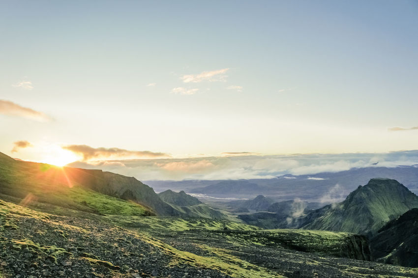 Hiking on Fimmvorduhals in summer, valley with moss covered mountainsides. Hicking Beauty In Nature Day Iceland Trip Landscape Mosscovered Mosscovered Rocks Mountain Mountain Range Nature No People Outdoors Scenics Sky Sunbeam Sunlight Sunset Tranquil Scene Treck