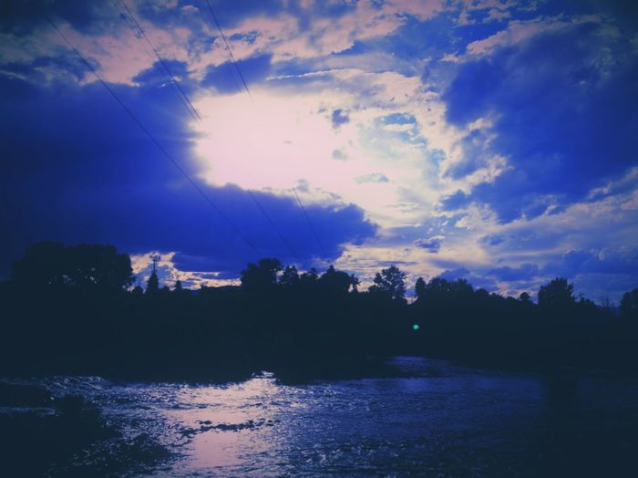 Clark Fork Water, Blue. Liquid, Montana Water Waterfront Tranquil Scene Sky Silhouette Scenics River Tranquility Tree Calm Beauty In Nature Lake Nature Rippled Cloud - Sky Cloud Blue Reflection Cloudy Sea