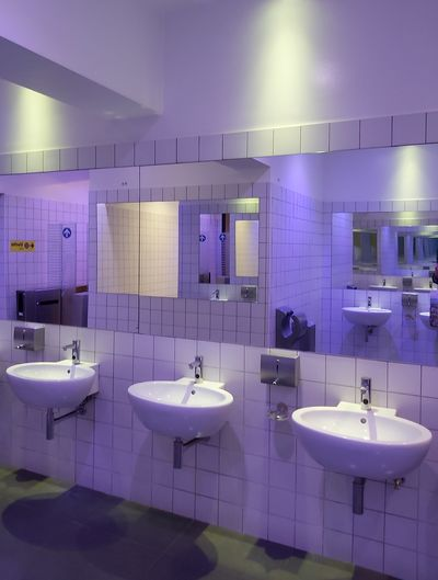 High angle view of sinks in illuminated public bathroom