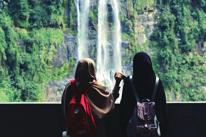 Women Around The World when I'm with You 👭 Wulaiwaterfall Waterfall Leisure Activity Hijabtraveller Proud To Be Muslimah Hijabsyari Power In Nature Holdinghands Rear View Tree Beauty In Nature Forest Two People Adults Only People Outdoors Friendship Adult Water Young Women Nature Only Women Day
