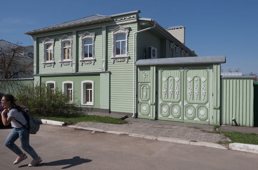 Russia, tourism, wooden house, Kolomna Russia Architecture Building Building Exterior Built Structure Casual Clothing Day Full Length House Leisure Activity Lifestyles Men Nature One Person Outdoors Real People Residential District Sky Standing Women Wooden House