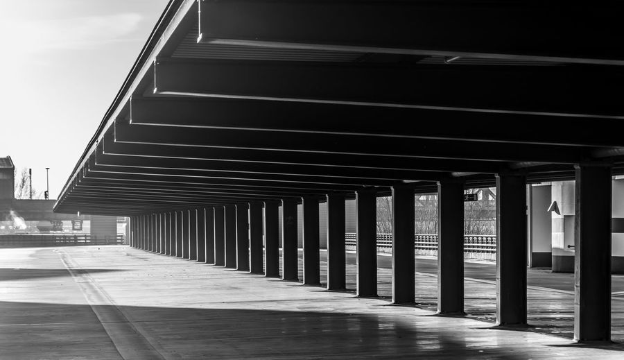 Architectural Column Architecture B&W Collection Berlin Photography Berliner Ansichten Black & White Black And White Built Structure Ceiling Day Empty In A Row Light And Shadow No People Outdoors Parkhaus Parking Area Parking Garage Parking Space Roof Sky Urban Exploration Urban Geometry