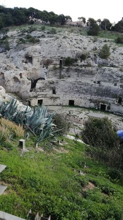 https://en.m.wikipedia.org/wiki/Roman_Amphitheatre_of_Cagliari Anphitheater Old Ancient History Ancient Sardinia Sardegna Italy  Nature Outdoors Day No People Grass Green Color Water Landscape Rock - Object Built Structure Architecture