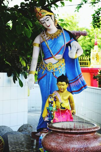 """Buddhist Statues, a mother and son images."" People Buddha Statues Buddha Low Angle View Multi Colored Place Of Worship Spirituality Nawfal Penang, Malaysia Outdoors Religion Sculpture Human Representation Statue"