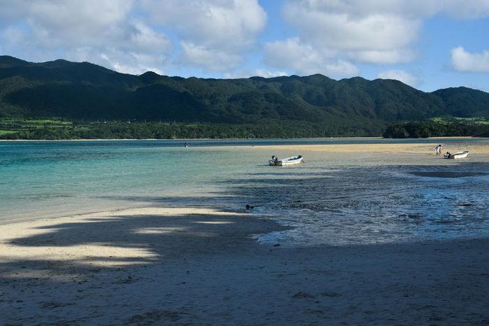 Beach Beauty In Nature Boat Cloud - Sky Ishigaki Island Landscape Mountain Mountain Range Nautical Vessel No People Outdoors Travel Destinations Water
