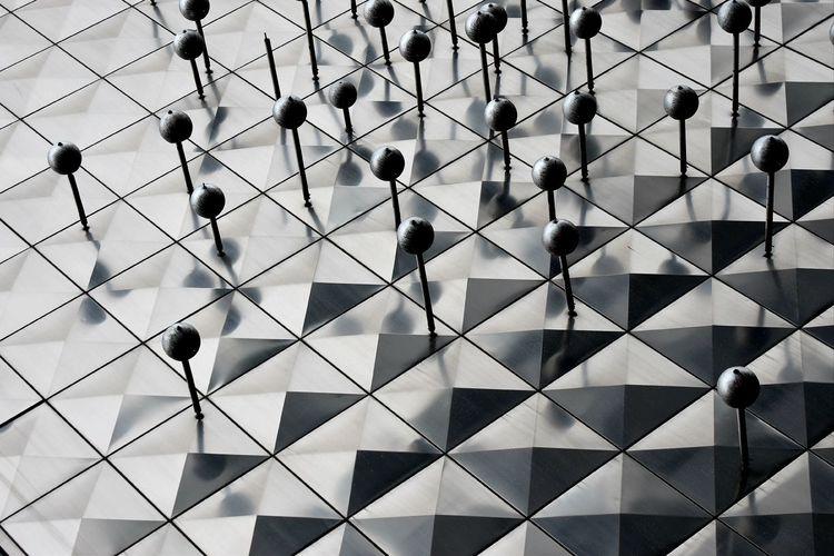 Full frame shot of people walking on tiled floor