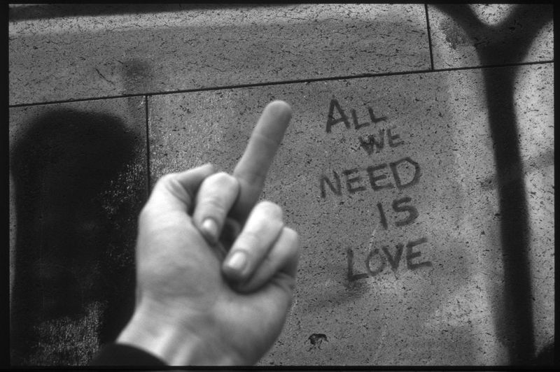 EyeEmNewHere Love All We Need Is Love Close-up Day Human Body Part Human Finger Human Hand Middle Finger One Person Text