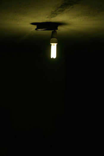 Light bulb in dark room Architecture Built Structure Ceiling Copy Space Dark Darkroom Domestic Room Electric Lamp Electric Light Electricity  Glowing Illuminated Indoors  Light Light - Natural Phenomenon Light Fixture Lighting Equipment Low Angle View Night No People Wall - Building Feature