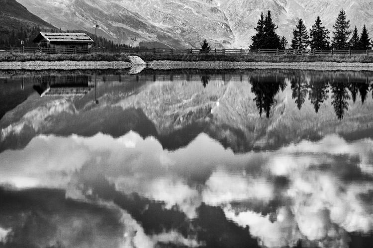 Edge Of The World clouds over the lake at the end of the world Mirror Landscape Endoftheworld Lakeview Blackandwhite Vipiteno Cloudy