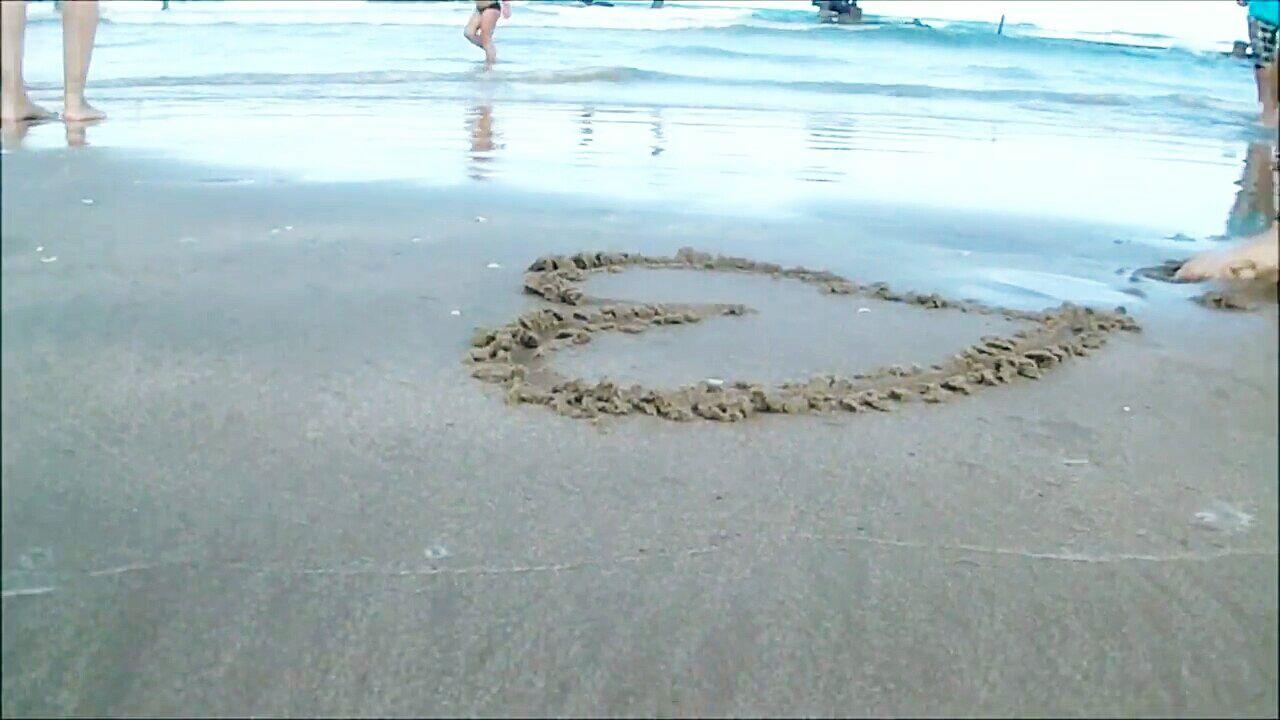 Heart Shape Made On Wet Sand At Beach