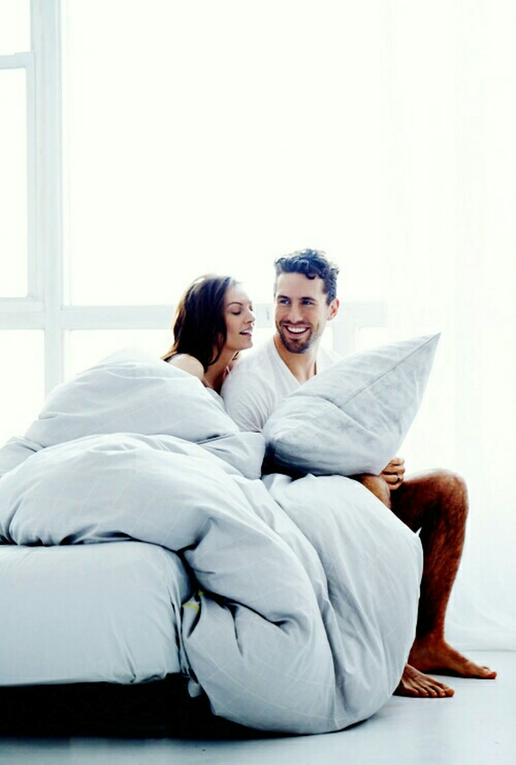 indoors, lifestyles, person, young adult, casual clothing, sitting, leisure activity, togetherness, relaxation, three quarter length, home interior, bonding, bed, young women, front view, sofa