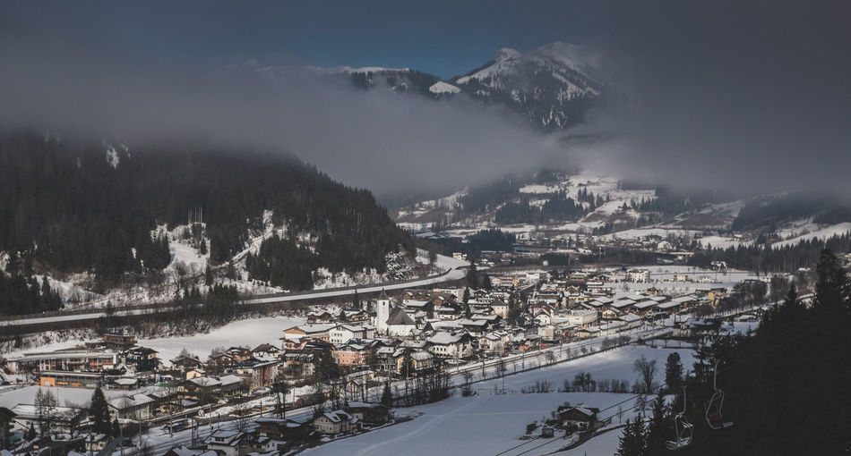High angle view of snowcapped mountains during winter and town