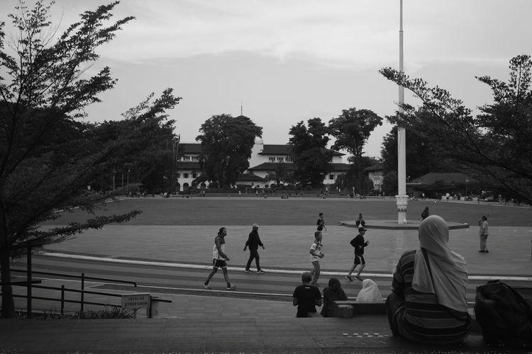 People on footpath against sky