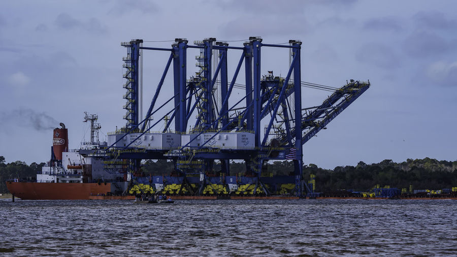 2 NEW Container Cranes being Delivered to the Port of Wilmington NC 3-29-18 all the way from China on this boat..... Cargo Ship Cranes Gigantic Boat Nikon Nikond750 Portofwilmingtonnc ThroughMyLens USCG WithMyTamron Large Ship Nature Outdoors River Sky Tamron150600mm Tugboat Water Wect